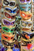picture of venetian carnival  - A rows of some venetian carnival masks - JPG