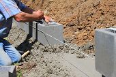 picture of bricklayer  - bricklayer builds a wall - JPG