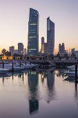 stock photo of kuwait  - Souk Sharq Marina and Kuwait City at dusk - JPG
