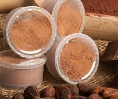 stock photo of cocoa beans  - Capsules of chocolate with cocoa powder cocoa beans and pieces of chocolate - JPG