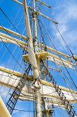 stock photo of sailing vessel  - Sails and tackles of a sailing vessel on a background of the sky - JPG