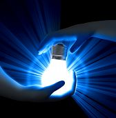 image of three dimensional shape  - Image of 3d light buld in hands - JPG