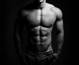 stock photo of human muscle  - bodybuilder posing - JPG