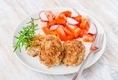 picture of pork chop  - Fried pork chop with tomato salsa on white plate - JPG