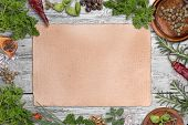 image of recipe card  - Green herbs as frame around a grungy paper for recipes - JPG