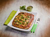 stock photo of pesto sauce  - homemade pizza with pesto sauce - JPG