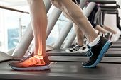 stock photo of treadmill  - Digital composite of Highlighted bones of man on treadmill - JPG