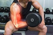 picture of weight-lifting  - Digital composite of Highlighted arm of strong man lifting weights - JPG