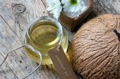pic of massage oil  - Coconut oil essential oil from nature a skin care that safe rich vintamin use in massage at spa organic cosmetic on wooden background - JPG