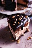 image of icing  - Delicious chocolate cake with icing in plate on table - JPG