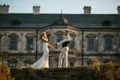 stock photo of old couple  - beautiful couple posing on a background of the old castle - JPG