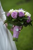 foto of purple rose  - bridal bouquet of purple and white roses in bride - JPG