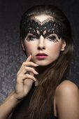 foto of face mask  - Beautiful stunning romantic woman with long brown hair beautiful dark make up with little pattern transparent black mask on her face - JPG
