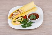 foto of shawarma  - Two Shawarma with chicken and parsley in white plate bowl with ketchup on wooden table - JPG