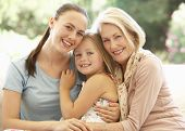 picture of grandmother  - Grandmother With Daughter and Granddaughter Laughing Together On Sofa - JPG