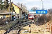 stock photo of motor coach  - engine carriage at railway station of Kourim - JPG