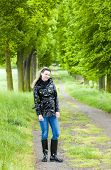 pic of woman boots  - woman wearing rubber boots in spring alley - JPG