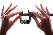 image of calipers  - Color horizontal shot of two hands holding a caliper and measuring the word  - JPG