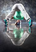 image of upside  - Young smiling woman modern dancer looking on camera upside down - JPG