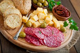 image of buffet catering  - Antipasto catering platter with salami and cheese on a wooden background - JPG