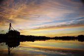 stock photo of burlington  - shot of sunset over echo lake grain mill in burlington wi - JPG