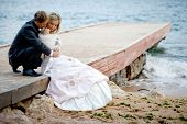 image of wedding couple  - Romantic wedding couple at beach - JPG