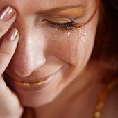 Closeup of crying woman with tears