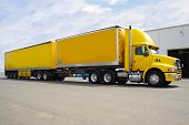 foto of b-double  - yellow b double truck with box containers for load - JPG