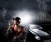 portrait of a woman with fur, a luxury car and a factory