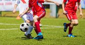 Постер, плакат: Soccer Football Teams Playing Soccer Football Match