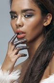 Постер, плакат: young beauty african american mulatto woman with fashion make up emotional face closeup