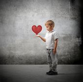 stock photo of holding hands  - Child holding a heart in his hands - JPG