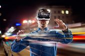 Double exposure, man wearing virtual reality goggles, night city poster