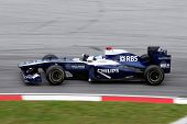 KUALA LUMPUR - APRIL 4: Williams team driver Rubens Barrichelo takes the hairpin turn on race day at