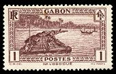vintage African stamp from Gabon depicting native worker on logging raft on the Ogooue river