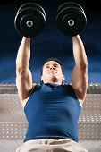 image of lifting weight  - Very strong and handsome man lifting weights  - JPG
