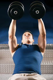picture of lifting weight  - Very strong and handsome man lifting weights  - JPG