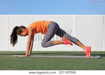 Fitness girl doing abs exercise