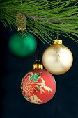 picture of christmas ornament  - An image of colored hanging Christmas ornaments - JPG
