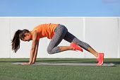 Fitness girl doing abs exercise to tone stomach muscles. Tiger curl reverse crunch planking bodyweig poster