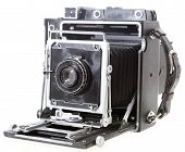 stock photo of workhorses  - A fully working 4x5 American press camera probably c.1958 with a 1920s lens isolated on white. This was the workhorse for a generation of US pressmen.