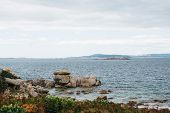 Beautiful seascape with rocky coastline and mountains on background in overcast weather, Galicia, No poster