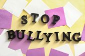 Text Stop bullying on table, top view poster