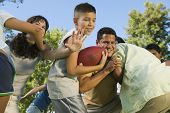 stock photo of mayhem  - Family Football Game - JPG