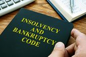 Man Holds Insolvency And Bankruptcy Code Ibc. poster