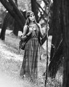 Young Hippie Woman With A Bag Walking Through The Woods. Black And White Photo poster