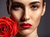 Beautiful young fashion woman with red lipstick. Glamour fashion model with bright gloss make-up  po poster
