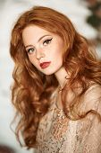 Portrait of a beautiful red-haired girl. Hair coloring. Hippie style. Bohemian style. poster