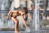Happy Children Playing In A Water Fountain poster