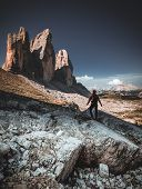 Backpacker On Trip Aound Tre Cime Di Lavaredo. View From Tour Around Popular Massive, Dolomite Alps, poster